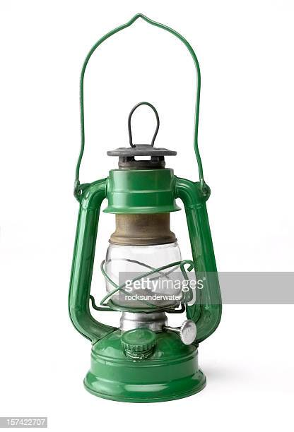 green oil lamp - lantern stock photos and pictures