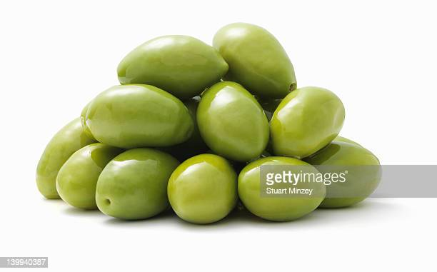 Green olives on a white background