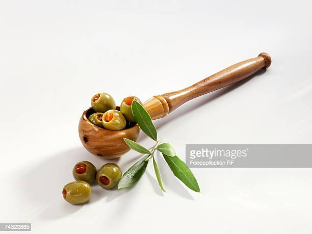 green olives stuffed with pepper - olive pimento stock photos and pictures