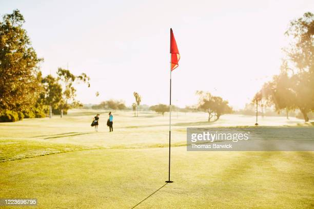 green on golf course at sunrise - golf stock pictures, royalty-free photos & images