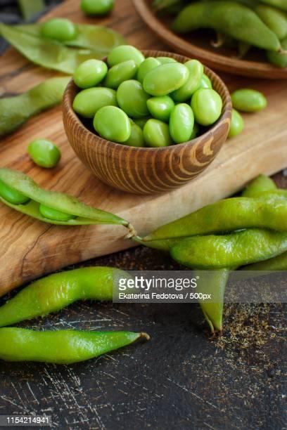 green organic edamame beans - edamame stock pictures, royalty-free photos & images
