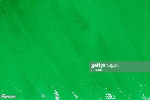 green paint brush strokes