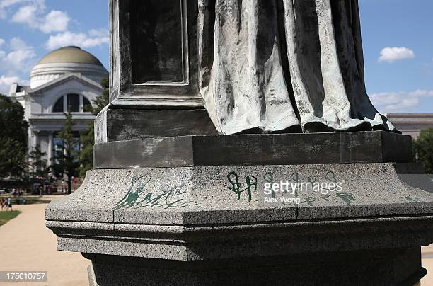 Green paint is seen on the pedestal of the statue of Joseph Henry the first Smithsonian secretary who served from 1846 to 1878 outside the...