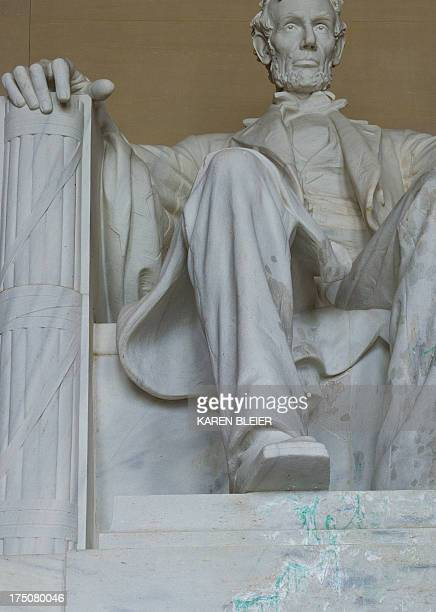 Green paint is seen on the statue of Abraham Lincoln July 30 2013 at the Lincoln Memorial in Washington DC Green paint was found early Friday morning...