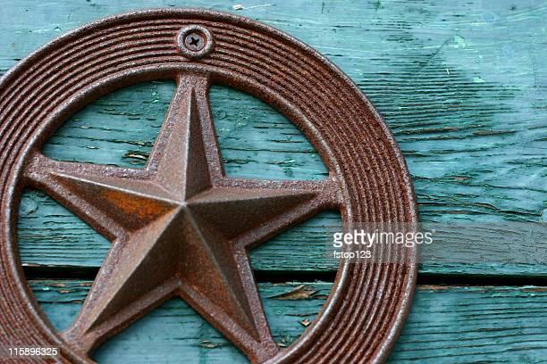 Green paint peeling, old wooden box, rustic iron Texas star.