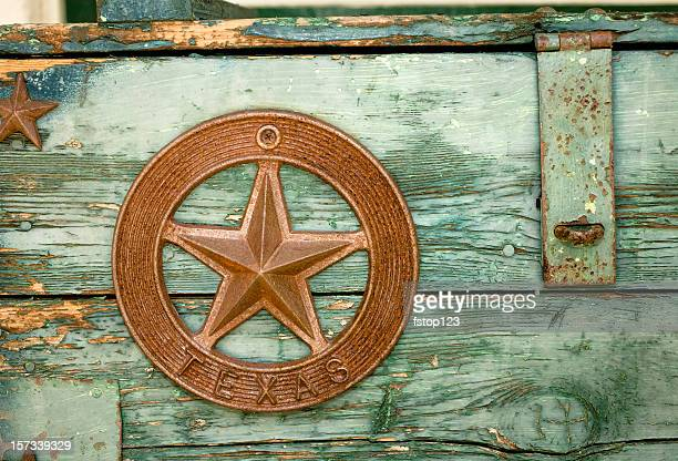 green paint peeling on wooden box with texas star - texas stock pictures, royalty-free photos & images
