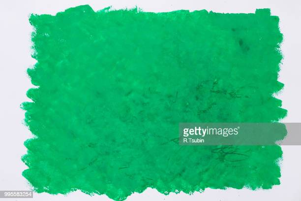 Green paint put on a white paper
