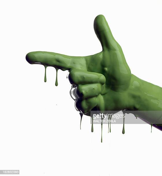 Green painted hand pointing