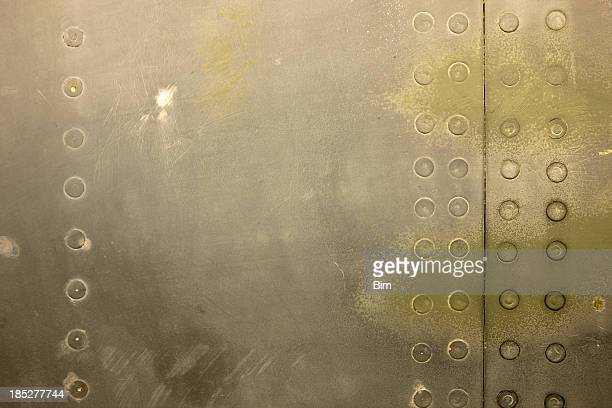 Green Painted Military Aircraft Background with Rivets
