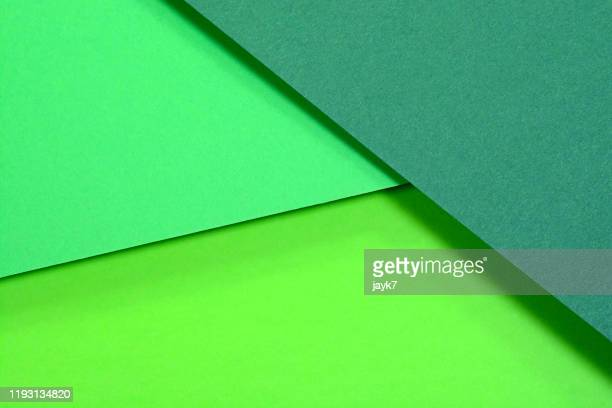 green paper background - shade stock pictures, royalty-free photos & images