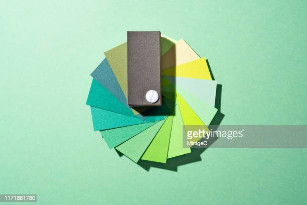 green paper color swatch - green colour ストックフォトと画像