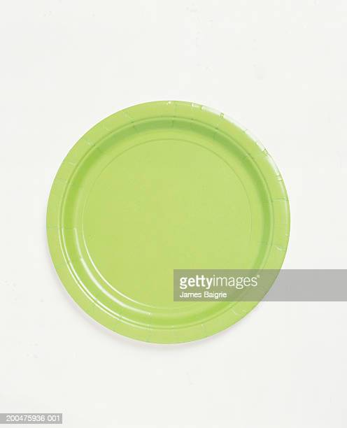 green paper plate, overhead view - paper plate stock photos and pictures