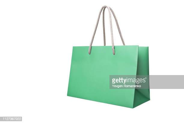 green paper shopping bags isolated on white background - 買い物袋 ストックフォトと画像