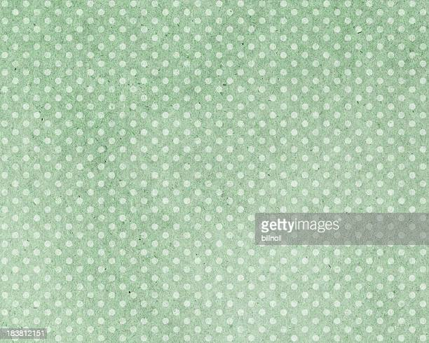green paper with dots