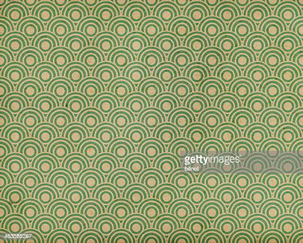 green paper with fishscale pattern