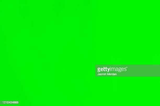 green paper with soft lines - chroma key foto e immagini stock