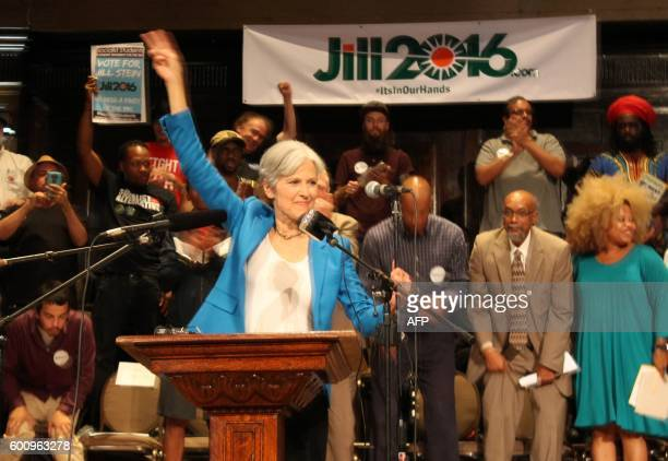 Green Party candidate Jill Stein waves a peace sign after discussing her active arrest warrant in North Dakota at a rally on September 8 2016 in...