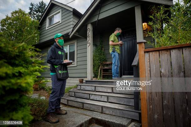 Green Party candidate Paul Manly goes door-to-door campaigning with campaign manager Ilan Goldenblatt in Nanaimo, British Columbia, September 5,...