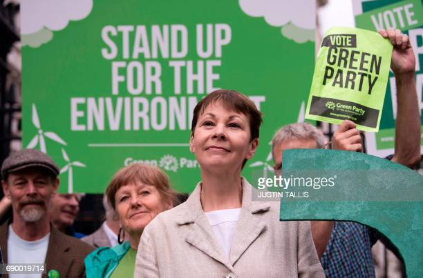 Green Party coleader Caroline Lucas poses for a photograph with a green question mark outside the entrance to Downing Street in central London on May...