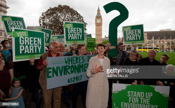 Green Party coleader Caroline Lucas speaks alongside a green question mark near the Elizabeth Tower more commonly referred to as Big Ben and the...