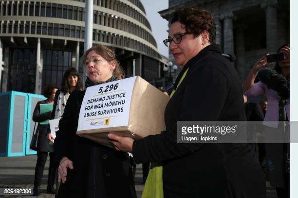Green Party coleader Metiria Turei receives a petition from organiser Anneleise Hall at Parliament on July 6 2017 in Wellington New Zealand The...