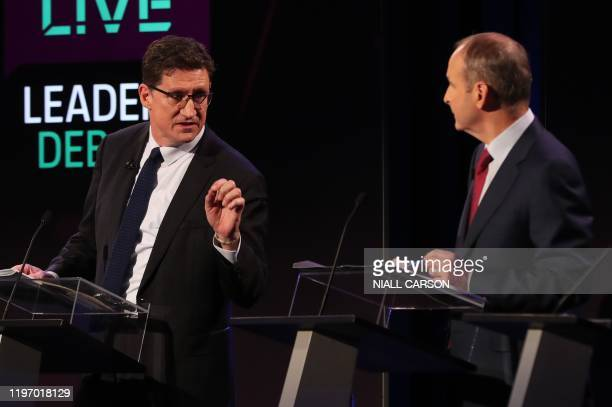 Green Party leader Eamon Ryan and Fianna Fail leader Micheal Martin participate in the seven way RTE leaders debate at the National University of...