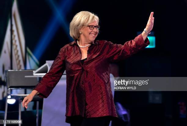 Green Party leader Elizabeth May waves as she walks on stage for the Federal leaders French language debate at the Canadian Museum of History in...