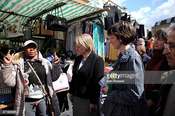 Green Party leader Natalie Bennett walks through Ridley Road Market while canvassing in the Borough of Hackney on April 30 2015 in London England The...