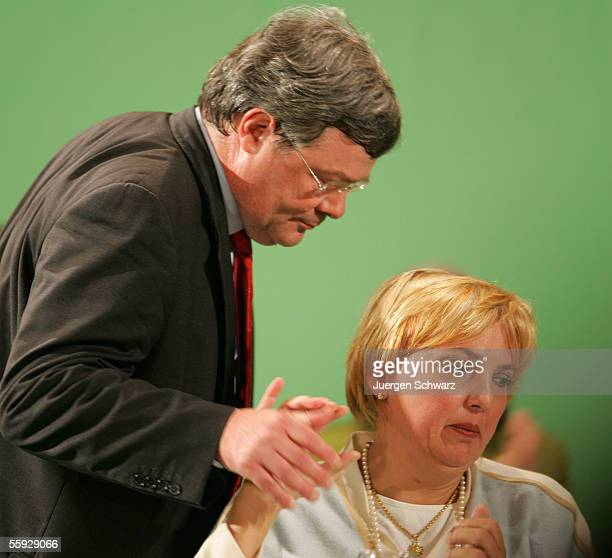 Green Party leader Reinhard Buetikofer touches the hand of Claudia Roth at the party congress October 15 2005 in Oldenburg Germany The Green Party...