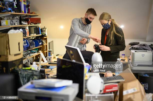 """Green Party leader Sian Berry is shown a donated camera in need of repair at the """"Save The World Club"""" charity headquarters during a mayoral election..."""