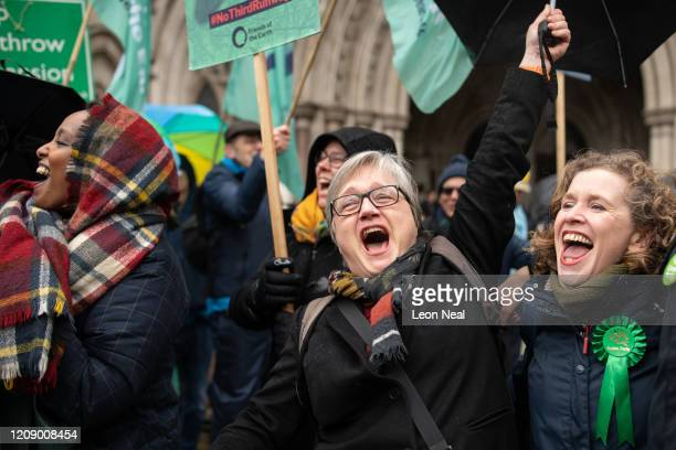 Green Party London Assembly Member Caroline Russell celebrates as she stands with fellow campaigners outside the Royal Courts of Justice following...