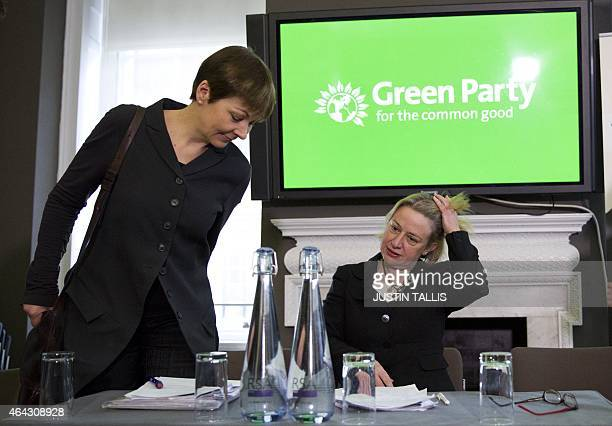 Green Party member of parliament Caroline Lucas and Green Party leader Natalie Bennett take their seats for a press conference to launch the party's...