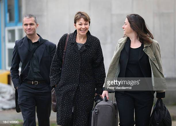 Green Party Member of Parliament Caroline Lucas arrives at Crawley Magistrates Court with her barrister and an assistant on October 16 2013 in...
