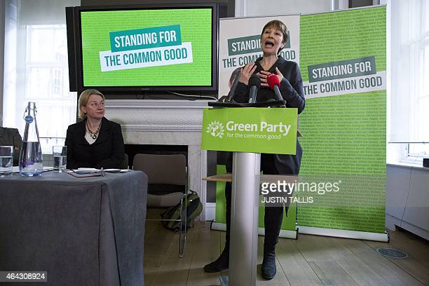 Green Party member of parliament Caroline Lucas speaks as Green Party leader Natalie Bennett listens during a press conference to launch the party's...