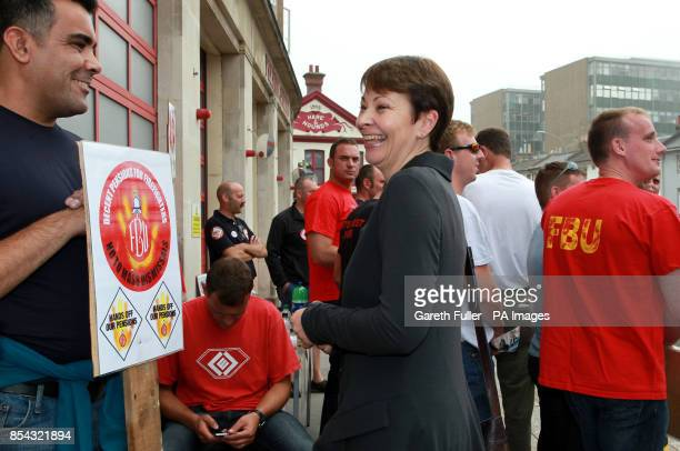 Green Party MP Caroline Lucas arrives at an FBU picket line in Brighton East Sussex as firefighters across England and Wales walked out on strike...