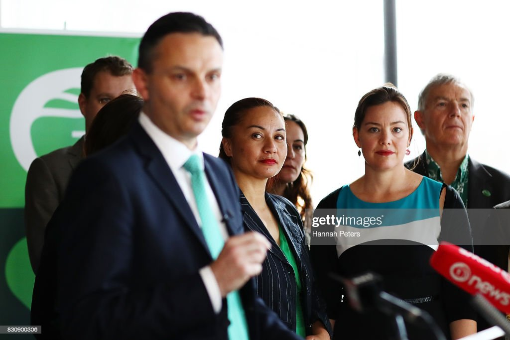 Green Party MPs Marama Davidson and Julie Ann Genter listen to Green Party leader James Shaw speak at the relaunch of the Greens Party on August 13, 2017 in Auckland, New Zealand. The Greens Party have relaunched their party with a new slogan 'Love New Zealand'.