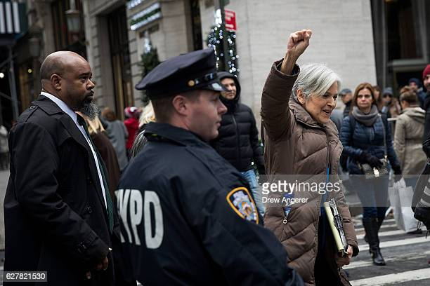 Green Party presidential candidate Jill Stein raises her first after speaking at a news conference on Fifth Avenue across the street from Trump Tower...
