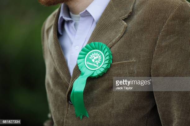 Green Party rosette sits on the lapel of a supporter's corduroy jacket as CoLeader of the Green Party Caroline Lucas launches the party's...
