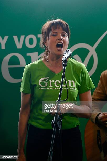 Green Party supporter Lucy Lawless sings during the Green Party election campaign event at St Kevins Arcade in Auckland on September 18 2014 in...