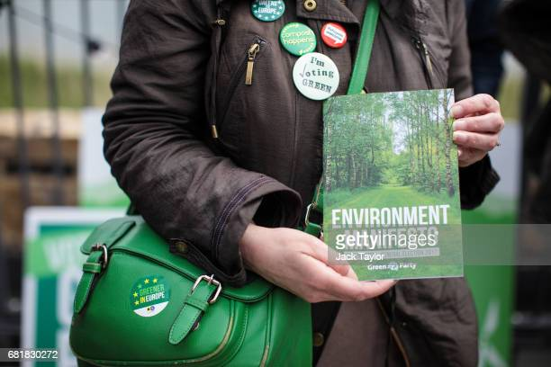 Green Party supporter wearing badges displays the party's environmental manifesto at its launch at the Woodberry Wetlands nature reserve on May 11...