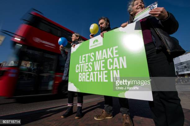 Green Party supporters hold placards during a photocall in Windrush Square Brixton as they call on the government to clean up Britain's air on...