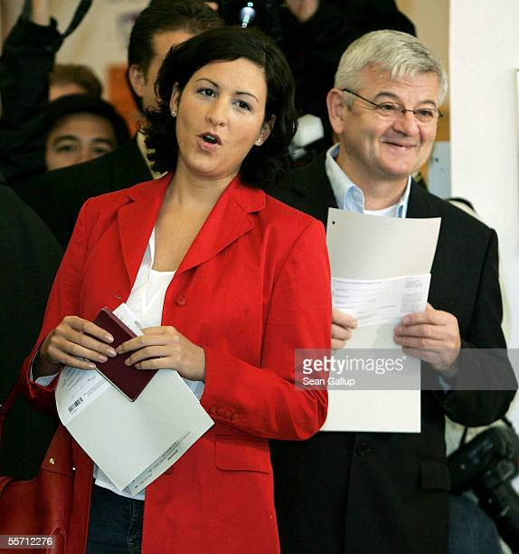 Green party top candidate Joschka Fischer and his girlfriend Minu Barati get ready to vote on September 18 2005 in Berlin Germany 62 million Germans...