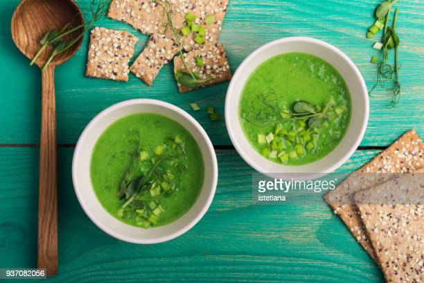 green pea cream soup  with sprouts on top - vegetable soup stock pictures, royalty-free photos & images