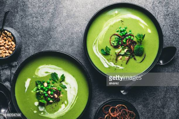 green peas cream soup - soup stock pictures, royalty-free photos & images