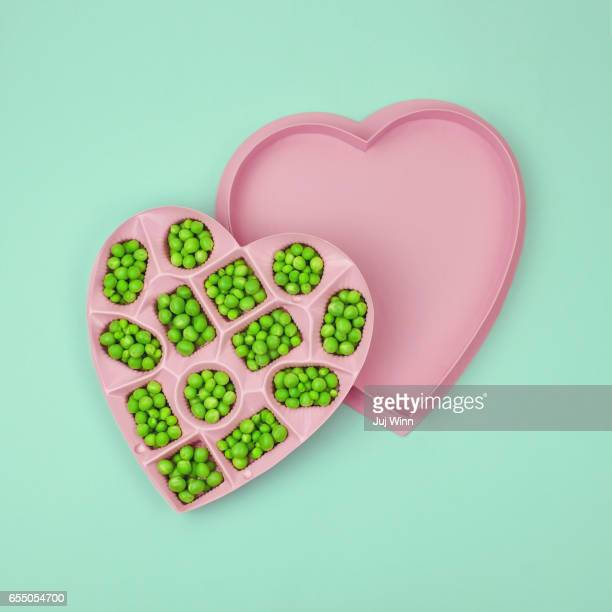 Green peas in a heart-shaped candy box