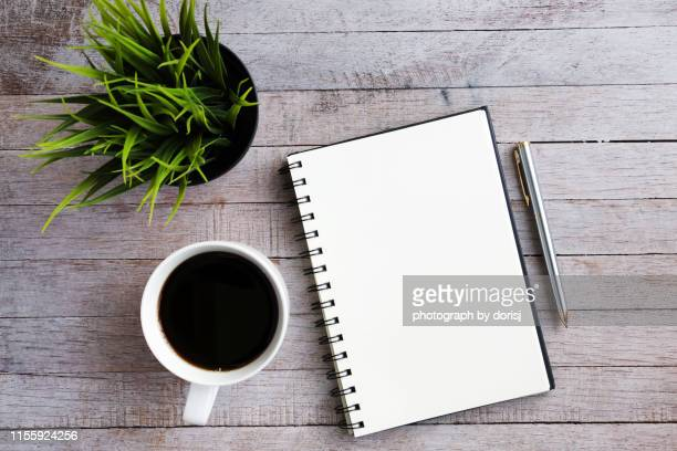 green plant, blank notebook and pen - diary stock pictures, royalty-free photos & images
