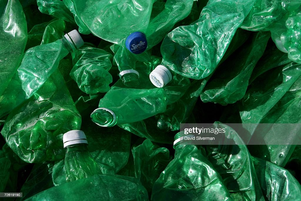 Green plastic bottles are separated from clear and blue bottles