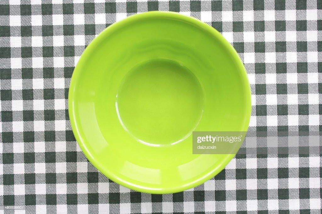 Green plastic bowl : Stock Photo