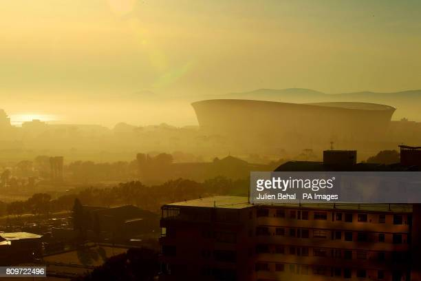 Green Point Stadium in Cape Town built for the 2010 World Cup in the early morning mist at dawn as the divide between the rich and poor in South...