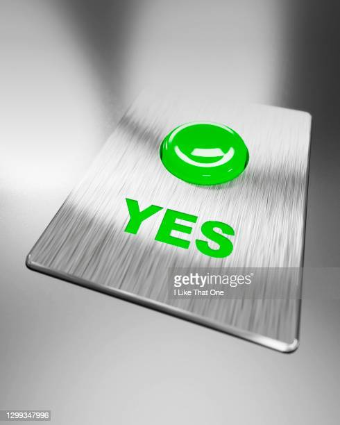 green positive yes button illuminated - atomic imagery stock pictures, royalty-free photos & images